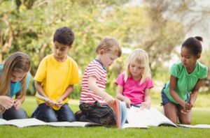 kids reading outdoors